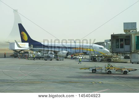 ABU DHABI, UAE - MARCH 10, 2015: Boeing 737 Next Gen Jet Airways undergoes pre-flight preparation at the airport of Abu Dhabi in the early morning