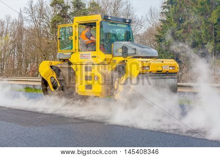 CZECH REPUBLIC, PLZEN, 7 MAY, 2016:Asphalt spreading machine and vibration roller  at pavement road works.