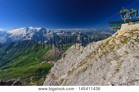 Dolomiti - aerial view of Pordoi pass from Sass pordoi mount. On background Mount Marmolada