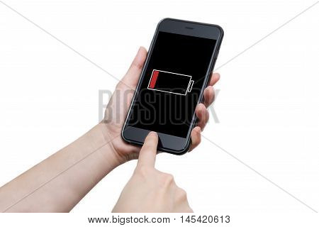 isolated hand using smart phone with low battery sign warning on the display screen