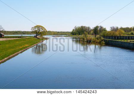Small river Pakalne reflects blue sky rusne island lithuania
