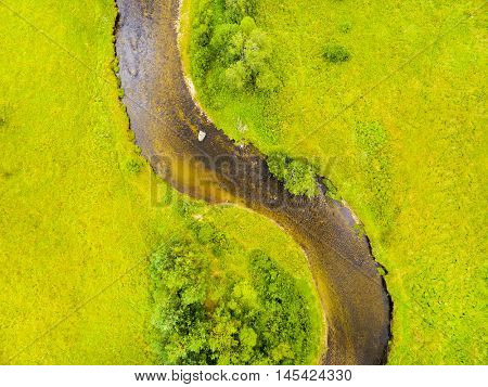 Aerial view of river meander in meadows. Gold-bearing river Kremelna in National Park Sumava. Czech Republic, Central Europe. European parks from above.