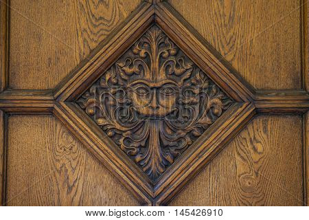 A beautiful carved door to Brasenose College in Oxford. The design a maned lion-like face is said to be an inspiration behind the famous CS Lewis book - The Lion The Witch and the Wardrobe.