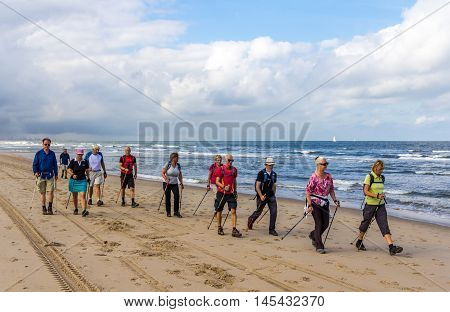 Kijkduin beach the Netherlands - September 03 2016: senior nordic walkers on the beach