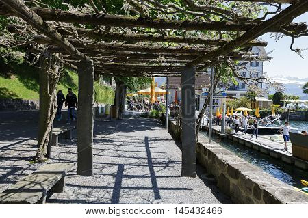 WEGGIS SWITZERLAND - MAY 05 2016: Pergola on the promenade extending along the shore of Lake Lucerne that is the perfect place to spend time and enjoy the beauty of nature