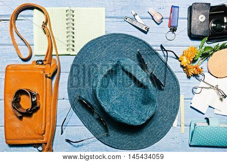Set of modern girl: female accessories on the blue planked surface. Flat lay