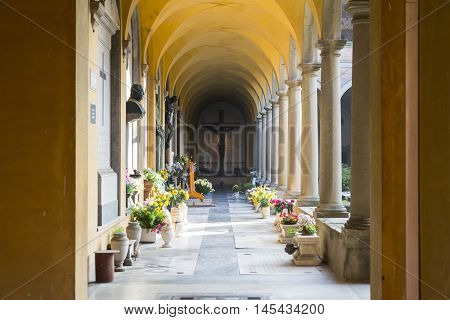 BOLOGNA,ITALY-DECEMBER 7,2016:Arcade inside the monumental cemetery of the Certosa di Bologna during a sunny day.