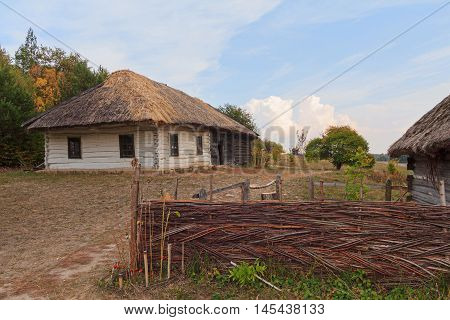 Old house of the peasants and the fence at the Museum of Pirogovo. Ukraine