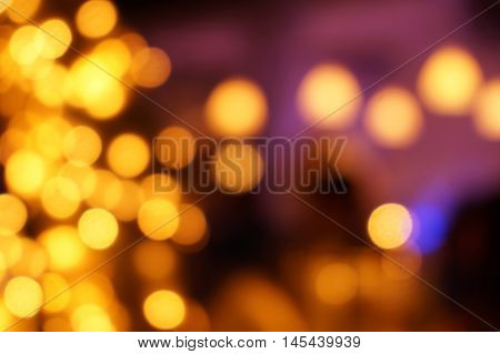 Yellow Bokeh Festive Lights on a Purple Blurred Background