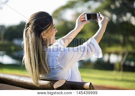 Pregnant Woman Making Self Portrait Using Smartphone.