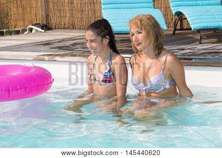 Cheerful Grand Mother With Little Girl Playing In Water