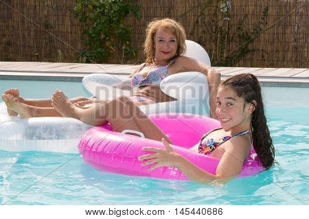 Grand Mother With Little Girl Playing In Water