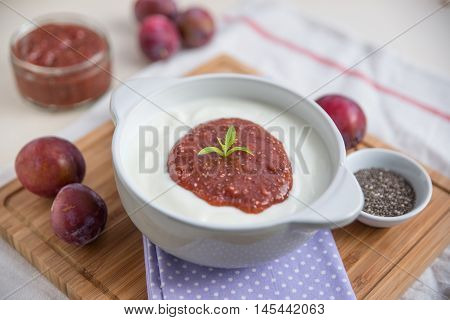 yogurt with plums and chia seeds for breakfast