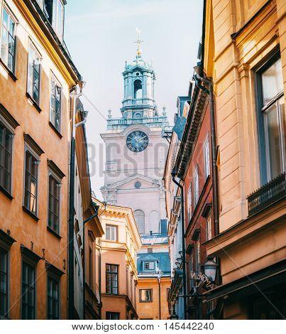 STOCKHOLM SWEDEN - OCTOBER 23 2014: View of the Cathedral of Saint Nicholas Sankt Nikolai kyrka or Storkyrkan Bell Tower beetwen houses in Stockholm Sweden.