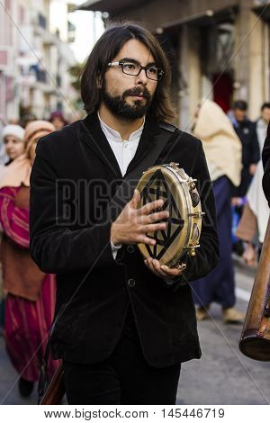 QUARTU S.E., ITALY: January 6, 2016: the procession of the Three Kings - Sardinia - participant at the event while playing the tambourine