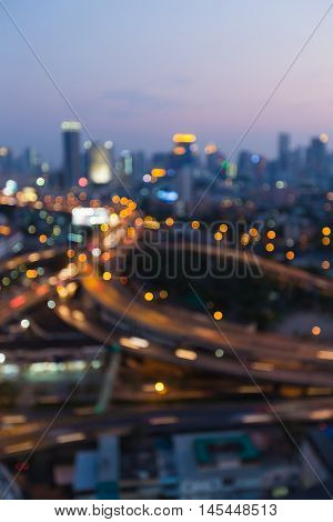 Blurred bokeh lights city and highway interchanged, abstract background