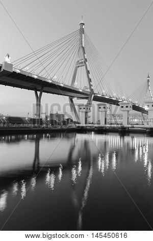 Black and White, Suspension Bridge over watergate with water reflection