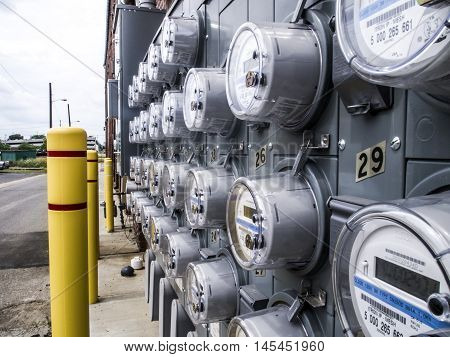 West Gas Avenue, York, Pennsylvania, USA - July, 26, 2016 -Panel of many electric meters along a brick wall