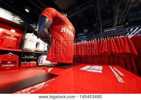 MOSCOW - DEC 25, 2014: Red t-shirts in shop in Spartak stadium. Stadium capacity - 45 000 people. Stadium was built in 2010-2018
