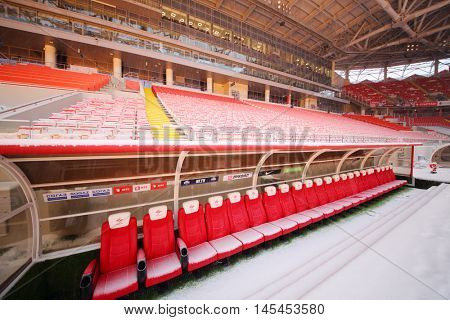 MOSCOW - DEC 25, 2014: Spartak stadium in snow - space for reserve players. New stadium is included in list of objects for games will be played at 2018 World Cup