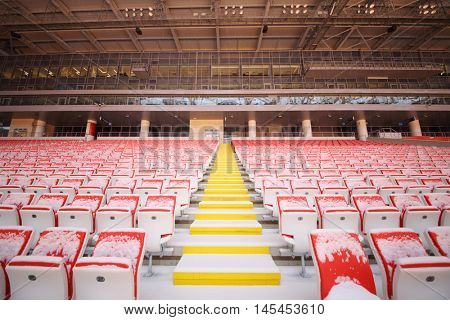 MOSCOW - DEC 25, 2014: Rows of red and yellow seats in new Spartak stadium. Stadium capacity - 45 000 people. Stadium was built in 2010-2014