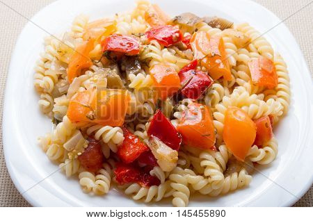 Italian Pasta Fusilli With Vegetable Ragout Of Peppers Closeup