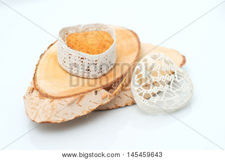 Cake in a casket in the form of heart on a section of wood