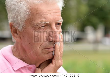 Portrait of an sad elderly nice man close up