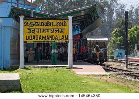 OOTY, TAMIL NADU, INDIA, 22 March 2015 : Nilgiri region. Railroad sign Udagamanadalam written in Tamil official language of Tamilnadu , Hindi and English on a platform of the railway station