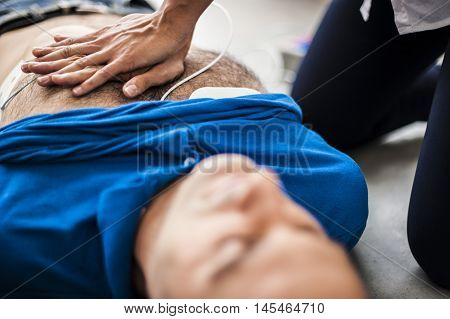 girl making cardiopulmonary resuscitation and heart massage