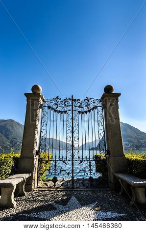 LUGANO SWITZERLAND - October 07: Panoramic landscape view of serene Gulf of Lugano lake and mountain San Salvatore from Monte Bre over clear blue sky on October 07 2015 in Lugano Switzerland