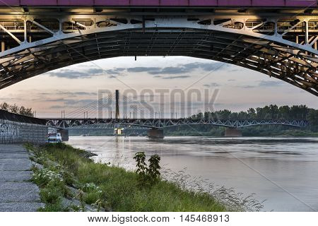 Swietokrzystki bridge over Vistula river during sundown Warsaw Poland