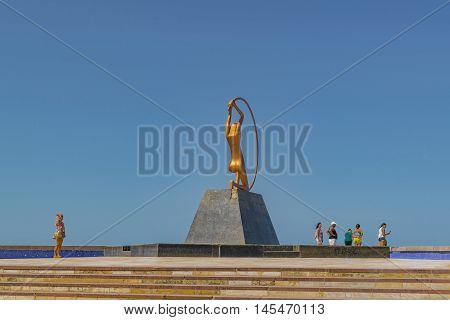 FORTALEZA, BRAZIL, DECEMBER - 2015 - People at monument dedicated to woman a modern sculpture located at iracema beach in Fortaleza Brazil
