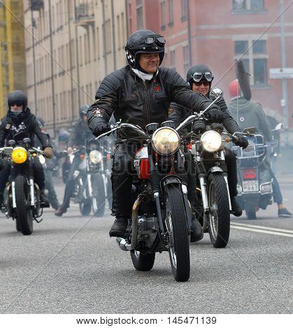 STOCKHOLM SWEDEN - SEPT 03 2016: Group of senior bikers on old fashioned motorcycles at the Mods vs Rockers event at the Saint Eriks bridge Stockholm Sweden September 03 2016