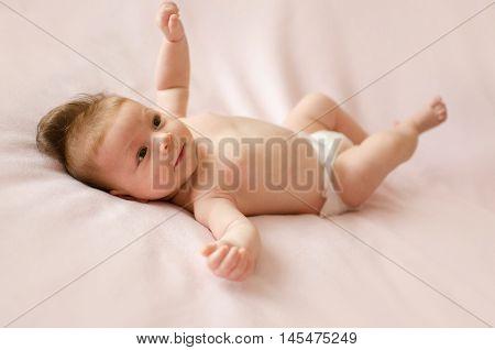 Baby Girl Lying On Back