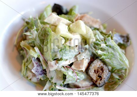 Waldorf salad with lettuce, apple, pickled walnut in a creamy dressing