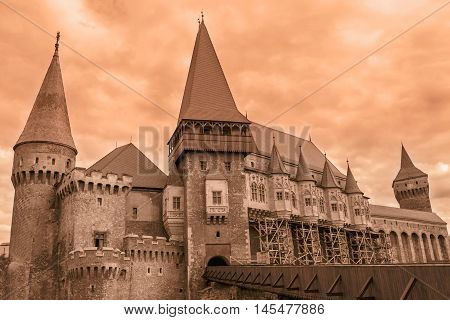 Beautiful View On Corvin Castles In Cloudy Weather Hunedoara Romania
