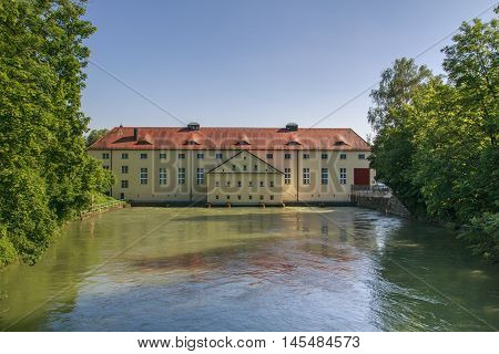 Building at the Isar-Werkkanal close to the Schinderbruecke in Munich with the Isar river passing by