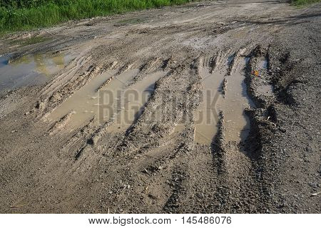 Track wheel on mud damage on road