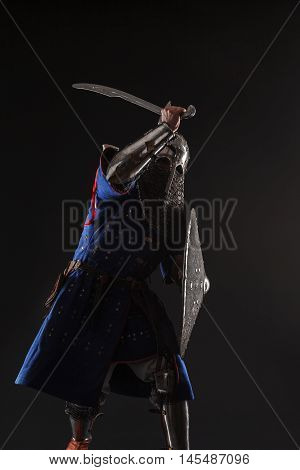 Mongol horde warrior in armour holding traditional saber