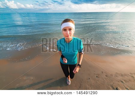 Young Sporty Girl Working Out On Beach At Sunrise In Morning