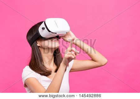Asian Woman experience though virtual reality device