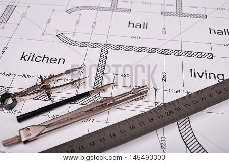 Construction of the building layout, building drawing on paper, a set of compasses for drawing of steel