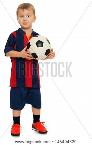Portrait of a cheerful little boy football player in a striped uniform. The boy holds a hand soccer ball. Portrait in full growth  - Isolated on white background