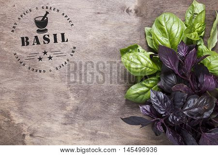 Circular stamp for spices - basil. A reprint of the stamp on a wooden surface with a bunch of basil.