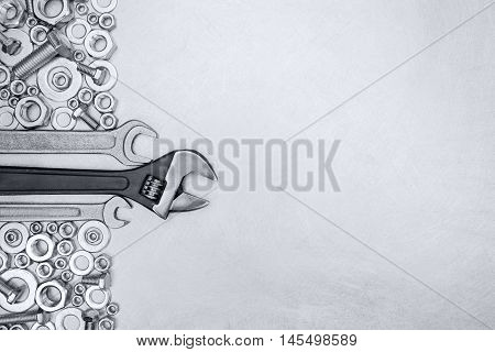Set Of Wrenches With Screws And Bolts On Grey Metal Background