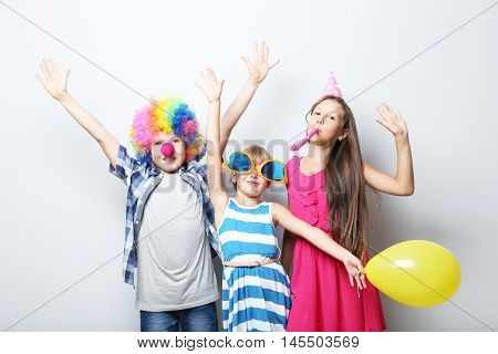 Portrait of childrens on the grey background