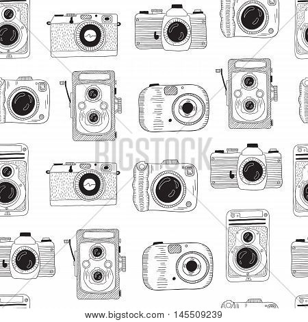 Photo cameras pattern. Vector hand drawn illustration.