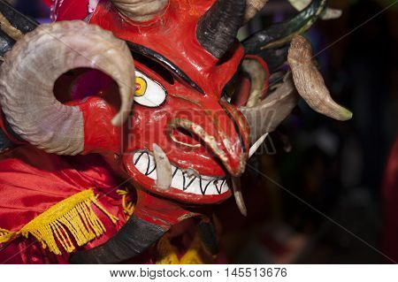 diabolic mask in Pillaro, painted in red