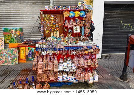 SANTO DOMINGO, DOMINICAN REPUBLIC - JANUARY 24: Dominican alcoholic liquor, called Mamajuana, sold as souvenirs on January 24 2016 in Conde street, Santo Domingo, Dominican Republic.